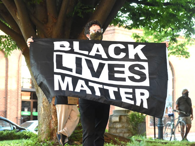 Protestors marched in downtown Staunton to the Augusta County Courthouse Saturday evening. They marched in a rally for George Floyd, a black man who died Monday in Minneapolis after a white police officer pressed his knee into Floyd's neck for nearly nine minutes.