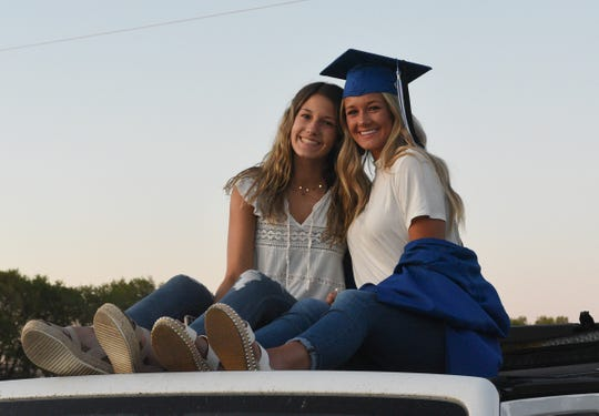 Macy and Maddy Ouart smile before Sartell's graduation ceremony Saturday, May 30, 2020, at Sartell High School.