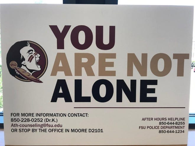 """The """"You are not alone"""" posters are part of the marketing campaign for FSU Athletics' counseling department."""
