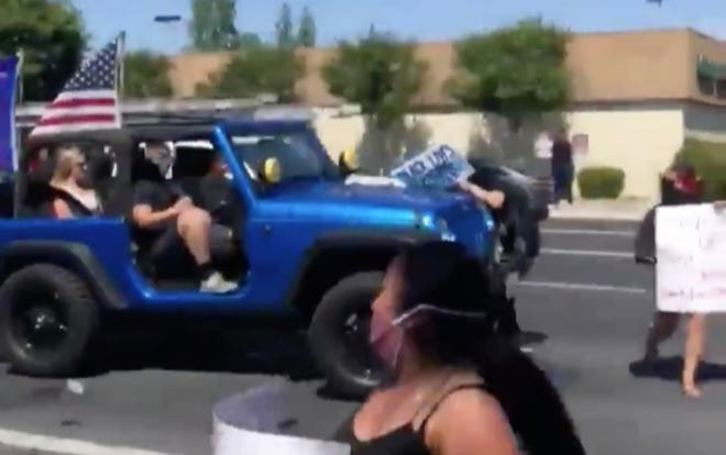 A screengrab of a Jeep hitting Black Lives Marchers at a Visalia protest on Saturday.