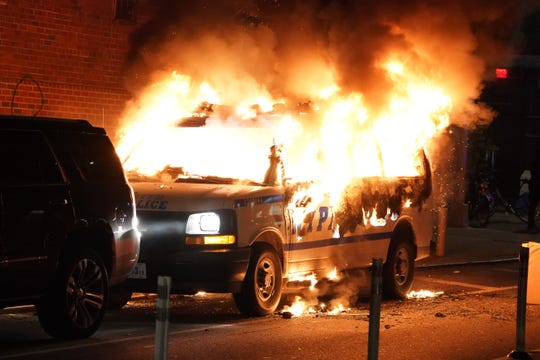 An NYPD van burning after it was set on fire by protesters during a chaotic protest over the death of George Floyd in New York, NY on May 30, 2020. (Photo/Christopher Sadowski)