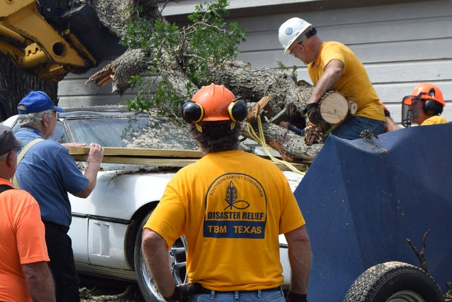 The Texas Baptist Men's Association in Bowie helps with damage caused by a tornado in the area May 22.