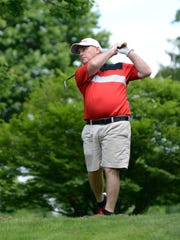 Warsaw native Brad Baker hits a tee shot on the par-3 17th hole on Saturday during the Zanesville District Golf Association 2-person Better Ball Tournament at Jaycees. Baker and teammate Scott Cope shot 8-under-par 63.