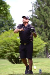Wes Parmer, from Zanesville, watches his tee shot on the par-3 17th hole during the Zanesville District Golf Association 2-person Better Ball Tournament on Saturday at Jaycees.
