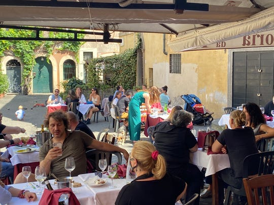 Lunchtime at Da Teo, a popular restaurant in Rome's Bohemian neighborhood of Trastevere. The restaurant's clientele is mostly made up of locals, which has allowed it to recover to around half the level of business it had before the coronavirus outbreak.