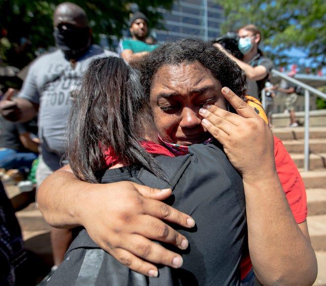 """Dzemila Hamzabegovic hugs Courtney Artis on Sunday, May 31, 2020, during a Black Lives Matter healing rally in front of KFC Yum! Center in downtown Louisville. The two were complete strangers before the event and embraced as they were overcome with emotion. """"For white people to think about us, it's powerful. It's emotional,"""" Artis said. """"Don't hurt us. We won't hurt you."""""""