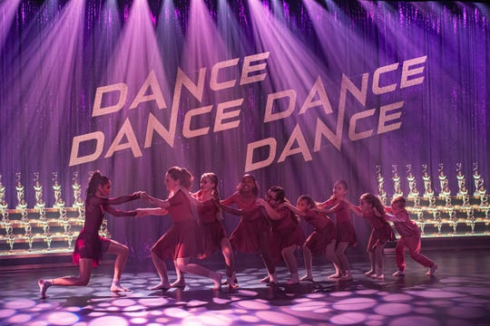 """Sofia Carson (far left) stars in the feel-good musical comedy as a failed Broadway star who returns to her hometown to train a bunch of young misfits for a big dance competition in """"Feel the Beat."""""""