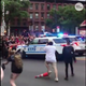 During a protest in New York, an NYPD SUV can be seen plowing into a crowd. It's unclear if there were injuries.