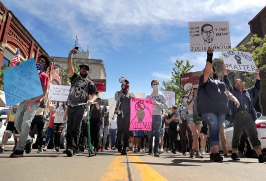 Protesters gather for a Black Lives Matter march and rally on Sunday, May 31, 2020, in Oshkosh, Wis. Protests have been happening across the country this week, after George Floyd, a 46-year-old black man, was killed Monday by a white Minneapolis police officer who knelt on his neck while arresting him.