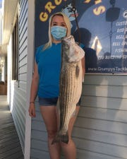 Britanny Gallo weighed in a 15-pound striped bass at Grumpy's Bait and Tackle in Seaside Park. Gallo caught the fish May 30 at Island Beach State Park.