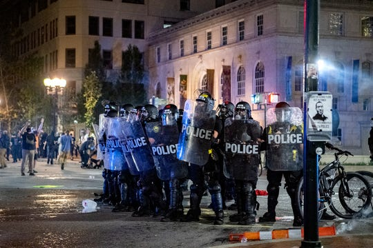 Hundreds of protestors swarmed the streets of downtown Asheville in response to the killing of George Floyd, who is black, by a white police officer in Minneapolis on May 31, 2020. Peaceful protest turned to tear gas as the night wore on.