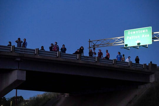 People watch from an overpass as protesters stand on Bowen Bridge in Asheville May 31, 2020.