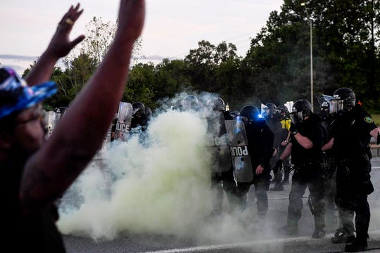 Police confront protesters on May 31 in Asheville.