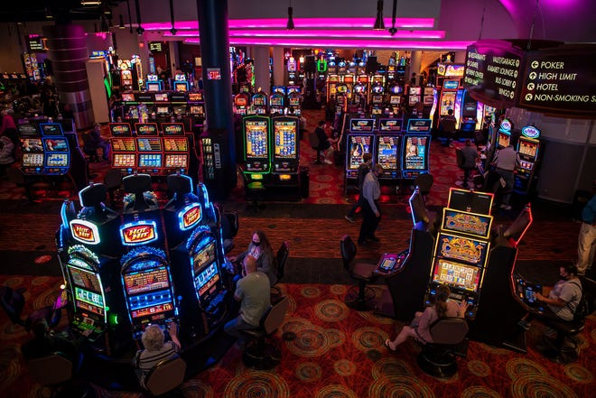 Patrons use every other slot machine on Monday, June 1, 2020 at FireKeepers Casino Hotel in Battle Creek, Mich. FireKeepers reopened to the public with new social distancing practices in place.