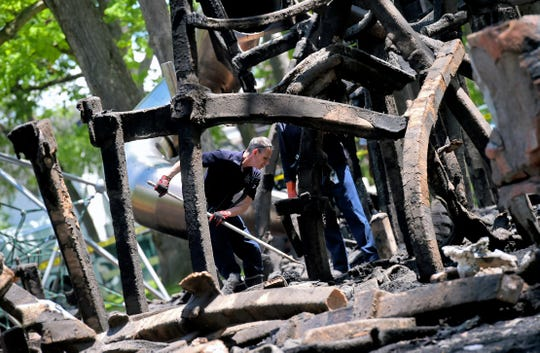 Firefighters sift through the remains of the OurSpace Playground at Recreation Park in Binghamton on Monday, June 1, 2020. Following a day of peaceful protests in Binghamton on Sunday, the accessible playground was set ablaze overnight.