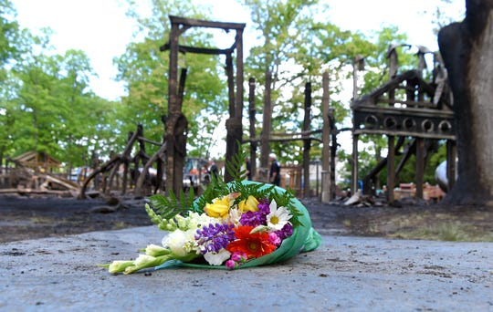 Flowers were left in front charred remains of the OurSpace Playground at Recreation Park in Binghamton on Monday, June 1, 2020. Following a day of peaceful protests in Binghamton on Sunday, the accessible playground was set ablaze overnight.