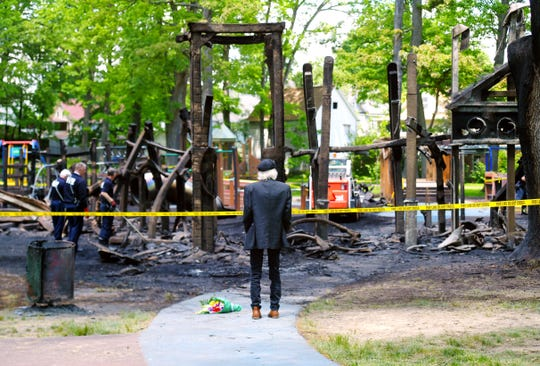 Onlookers observes as Binghamton firefighters begin cleanup of OurSpace Playground at Recreation Park in Binghamton on Monday, June 1, 2020. Following a day of peaceful protests in Binghamton on Sunday, the accessible playground was set ablaze overnight.