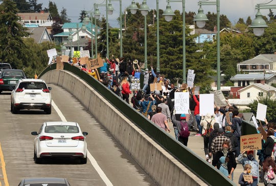 Call for Justice with Kitsap ERACE Coalition protesters fill the pedestrian pathway of the Manette Bridge in Bremerton on Sunday.