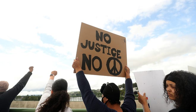 Call for Justice with Kitsap ERACE Coalition protest at the Manette Bridge in Bremerton on Sunday May 31, 2020.