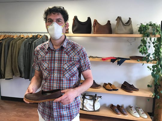 Matt Renna of Queen City Dry Goods, holds the new Vermont House Shoe he launched about a month ago.