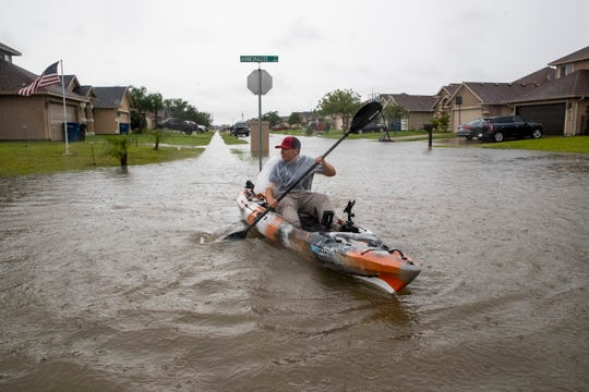 A man kayaks down a flooded Annemasse Street on Monday, June 1, 2020.