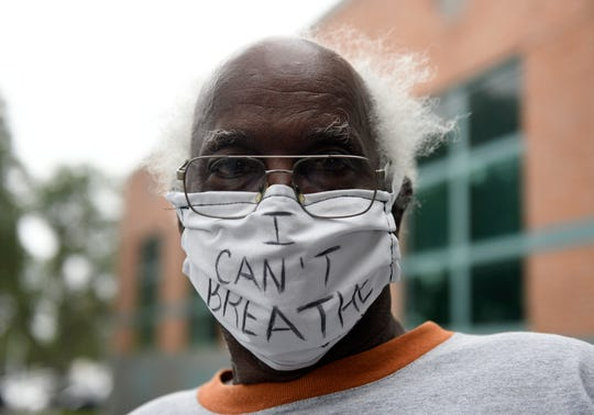 """Leonard Henderson wears a mask that says """"I can't breathe"""" at the Black Lives Matter protest, Sunday, May 31, 2020. Henderson lives in Corpus Christi."""