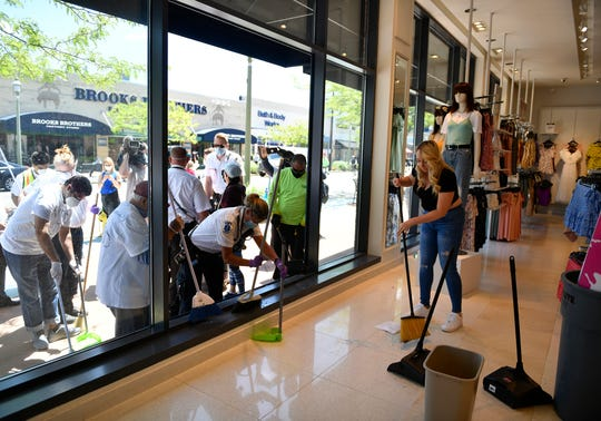 Volunteers cleanup broken glass outside Foreever 21 in Atlantic City following Sunday night's protest against police violence after the death of Minnesota man George Floyd. June, 1, 2020.