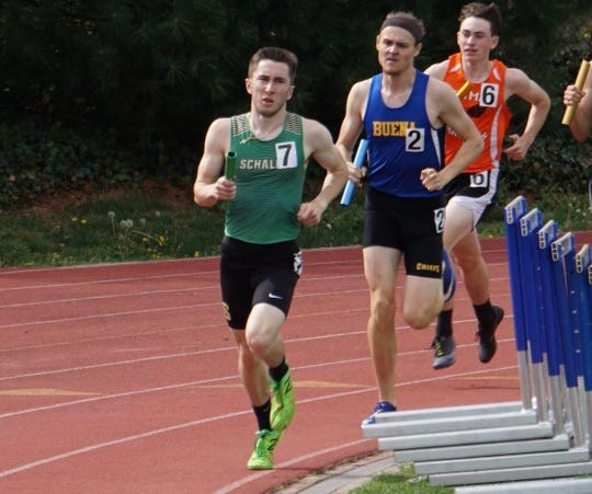 Schalick's Greg McGuire rounds the turn at last year's Woodbury Relays. The senior was regarded as one of the top 800-meter runners in the region this spring