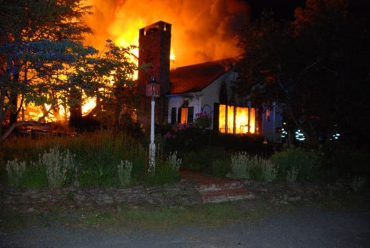 After they were awoken by a fire detector, the residents of a Readington home destroyed by fire this morning narrowly escaped, authorities said.