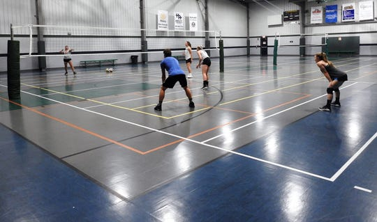 DJ Bradford, a volleyball coach for Ridgewood and Kids America, works on some skills with teens recently at the 89,000 square-foot facility. Kids America reopened May 26 with most of its amenities open for use.