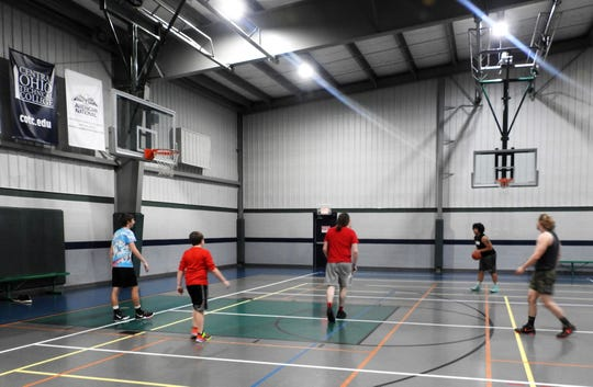 Teens play basketball recently at Kids American, which reopened on May 26 following the COVID-19 pandemic closure. Organized activities and programs aren't open yet, but amenities are open for use like the basketball courts.