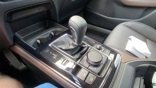 The CX-30 has a six-speed automatic transmission and a rotary control for navigation, smart phones, etc.
