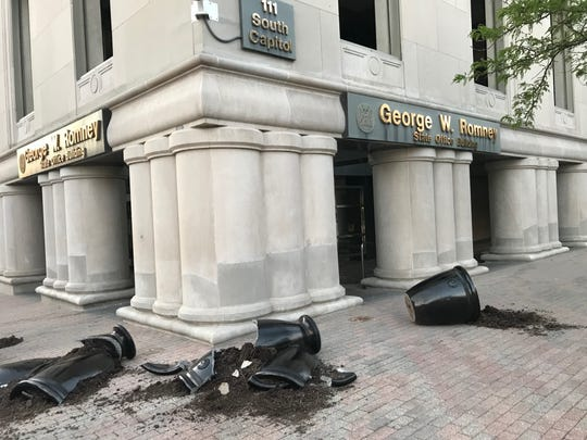 Flower pots and glass in doors and windows in the building housing the offices of Gov. Gretchen Whitmer were smashed Sunday during demonstrations in downtown Lansing.