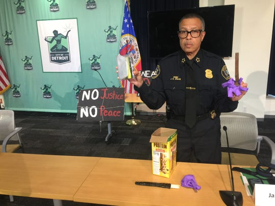 Detroit Police Chief James Craig  holds up what city officials are claiming is proof that agitators undermined peaceful anti-police brutality protests in Detroit including a rusty iron railroad strike hidden in a box of protein bars.