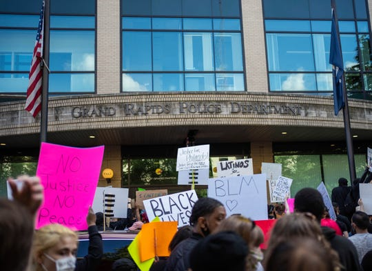 People gather in front of the Grand Rapids Police Department in downtown Grand Rapids, Mich., Saturday, May 30, 2020, to protest police brutality in the United States.