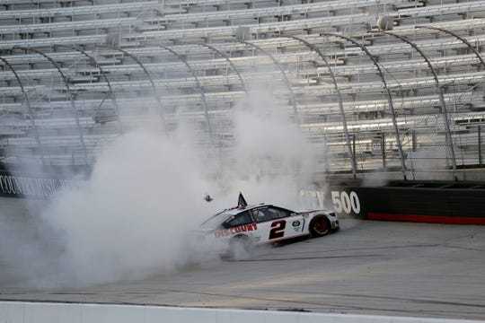 Brad Keselowski does a burnout after winning after winning Sunday at Bristol.