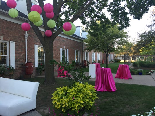 Festive touches like paper lanterns signal a special occasion. Colorful high-top tables are ideal for a strolling graduation party or any other al fresco affair.