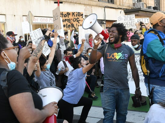 Organizer Trystan Taylor chants with the crowd. Protesters march against police brutality in Detroit on May 31, 2020.