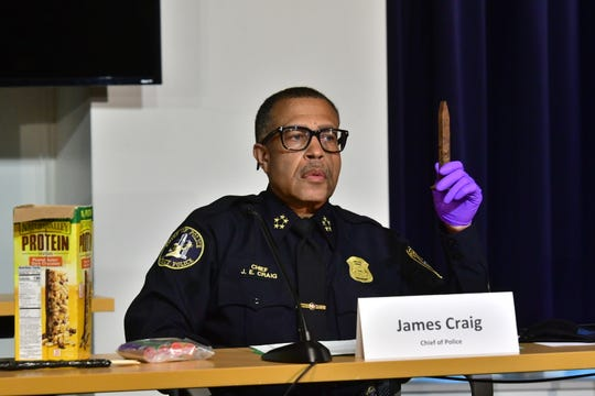 Detroit police chief James Craig holds up a railroad spike during a press conference June 1, 2020, that he claimed was hidden in a box of food to be used as a weapon against the police during protests in the city Sunday evening.