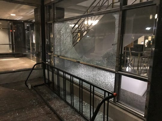 Protesters smashed a window at the Romney Building, which is home to Gov. Gretchen  Whitmer's office on Sunday, May 31, 2020.