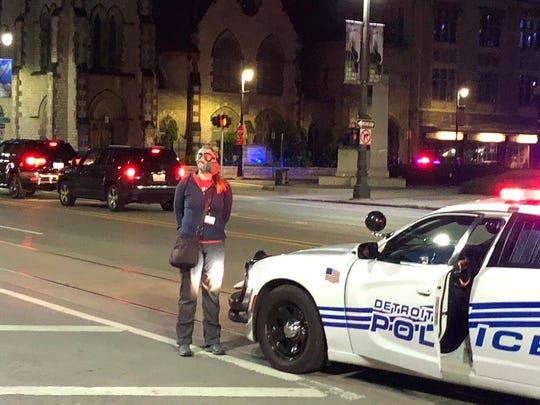Detroit News reporter Christine MacDonald was handcuffed in Detroit on Sunday while reporting on police arrests of demonstrators.
