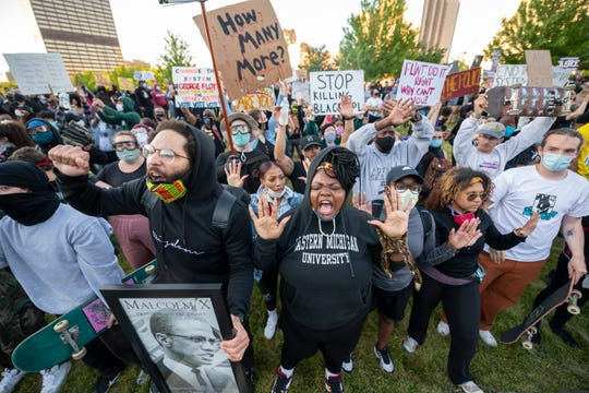 Protestors yell in front of the Detroit Police Safety Headquarters, in Detroit May 31, 2020 to protest the death of George Floyd.
