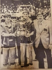 Mark Riggins (left), Bill Butcher (center) and Jack with the 1975 state runner-up trophy.