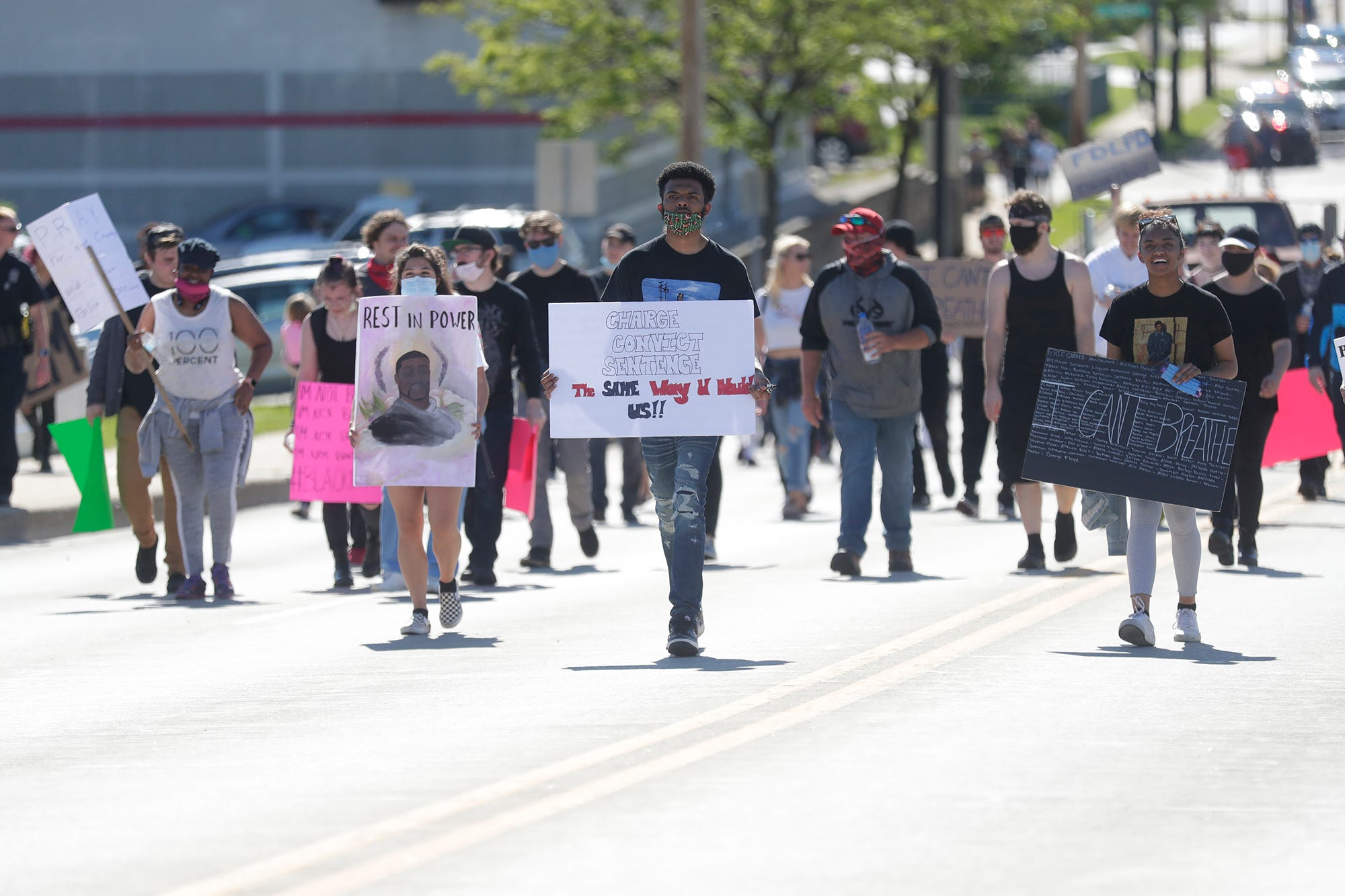 Dozens of people walk in protest Sunday, May 31, 2020, on Johnson Street in Fond du Lac, Wis. The group is protesting police brutality toward blacks stemming from an incident that occurred in Minneapolis, Minnesota, on May 25, 2020, when George Floyd was killed while being taken into police custody.