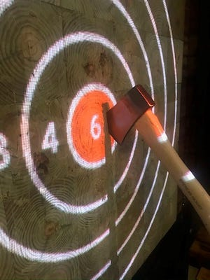 Gator Mike's recently opened an ax-throwing venue. In the growing sport, people throw small axes and try to hit the target.