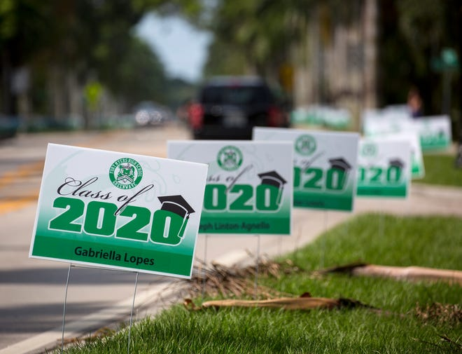 Hundreds of signs honoring Fort Myers High School graduates line a section of McGregor Boulevard on Monday, June 1, 2020, in Fort Myers.
