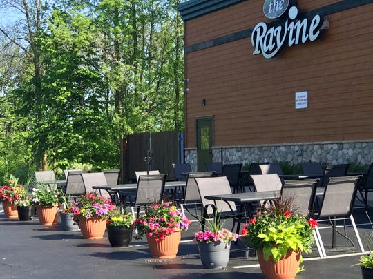 The Ravine Pub & Grill, 2633 Manitowoc Road in Bellevue, has transformed part of its parking lot into an outdoor patio.