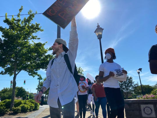 Protest organizer Justin Sportsman leads a march in Pickens on Monday, June 1, 2020.