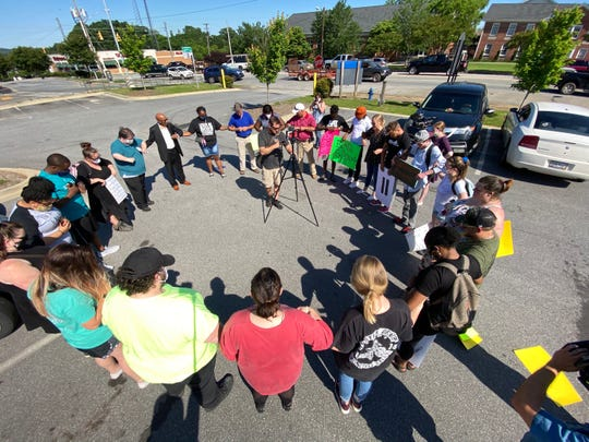 Protesters and supporters gather in a prayer circle before marching in Pickens on Monday, June 1, 2020.