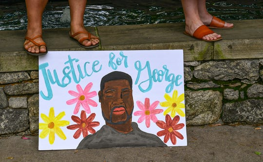 """A painting """"Justice for George"""" at Tate Plaza during a protest remembering George Floyd at Falls Park in Greenville Sunday, May  31, 2020."""